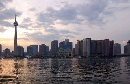 Toronto skyline from Ontario lake in time of sunset photo