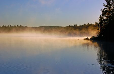 algonquin park: Sunrise and mist in beautiful lake in Algonquin Park