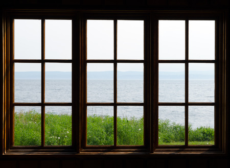 view through: Sea view through window in sunny day