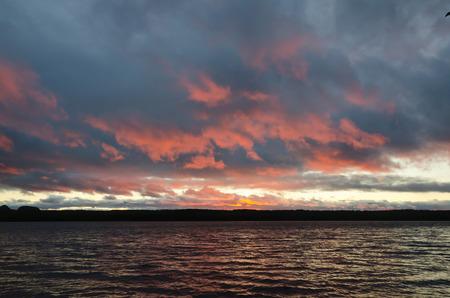 superior: Rocky shore of Superior Lake at sunset Stock Photo