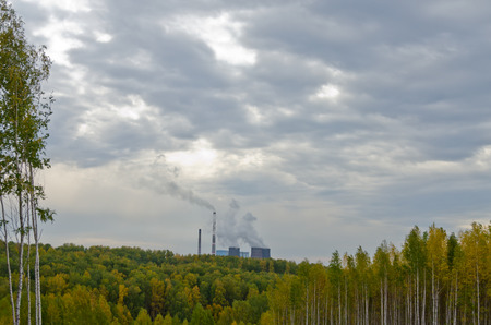 electric power station: Coal power station behind fall forest Stock Photo