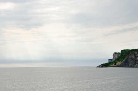lawrence: Gray water of St. Lawrence gulf in sunet time
