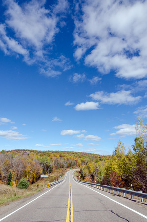 provincial forest parks: Road in Algonquin Park during the fall season Stock Photo