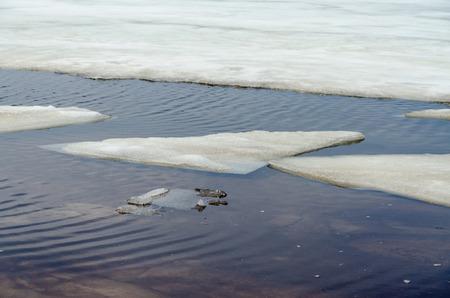 michigan snow: Melting ice on  sandy beach of Upper Peninsula, Michigan
