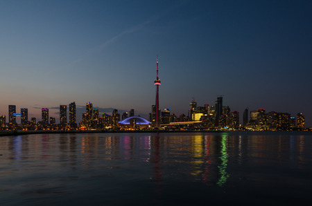 skyscape: Skyline of Toronto over Ontario Lake after sunset