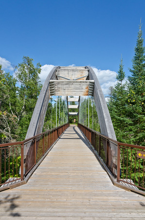 restful: Curved wooden bridge in Ouimet Canyon near Thunder bay
