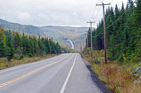 endless road: Autumn endless road under cloudscape, Quebec, Canada