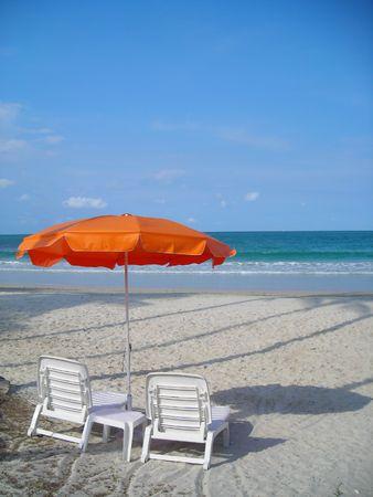 Two chairs facing beach @ Bintan, Indonesia with copyspace photo