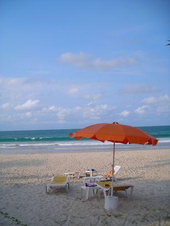 Deck chairs facing beach at Bintan Indonesia photo