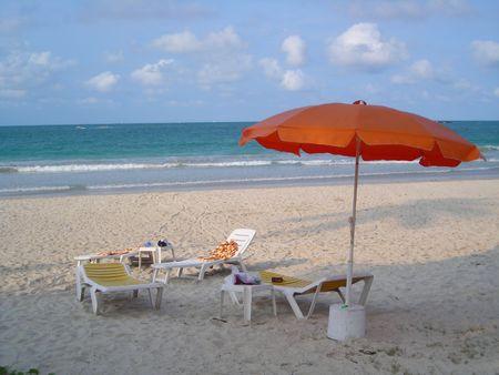 Deck chairs at beach at Bintan Indonesia Stock Photo