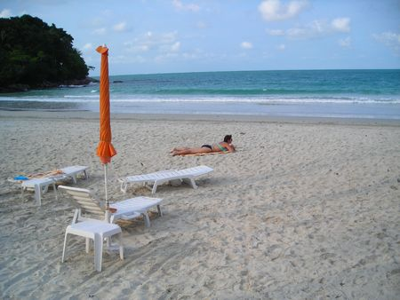 Woman relaxing and enjoying herself as she lay on the beach. photo