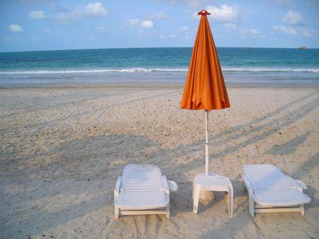 Two deck chairs facing beach at Bintan Indonesia Stock Photo