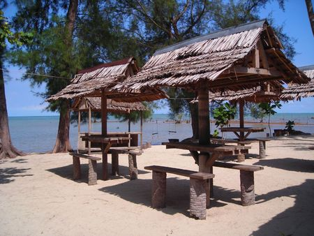 forgotten: Rustic huts by the beach at Bintan, Indonesia. Forgotten era.