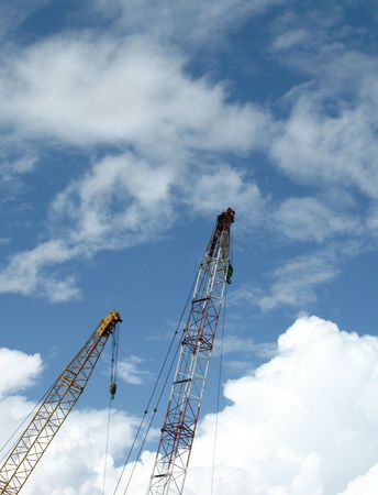 Double construction crane against blue sky with lots of copyspace Stock Photo - 758096