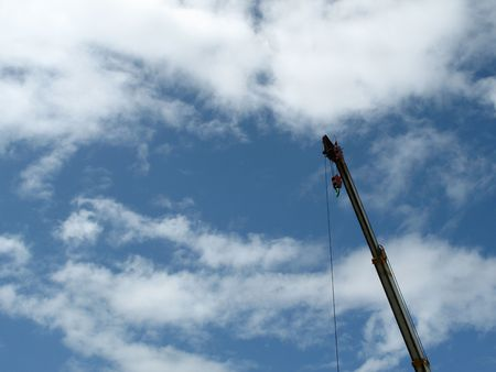 Single contruction crane against blue sky with lots of copyspace Stock Photo - 758093