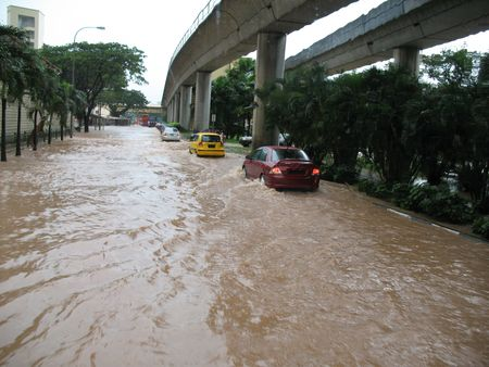 natural disaster: A rare sight in Singapore - flooded street Stock Photo