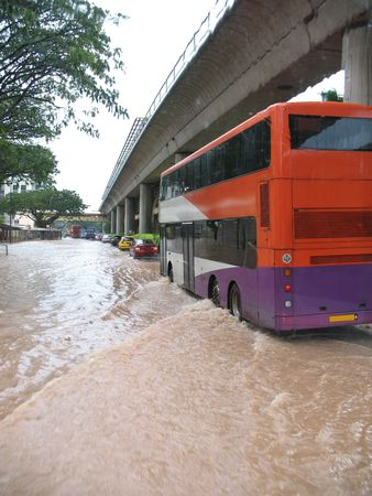 muddy tracks: A rare sight - flooded street in Singapore Stock Photo