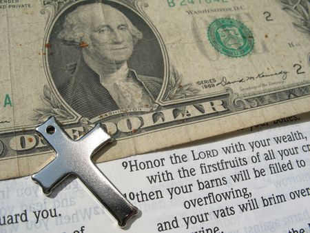 Word of God with Cross and Money open to bible verse :- Proverbs 3:9-10 Honor the LORD with your wealth, with the firstfruits of all your crops; then your barns will be filled to overflowing, and your vats will brim over with new wine.