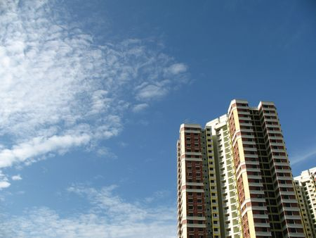 block of flats: A block of HDB Flats found in Singapore against blue sky.