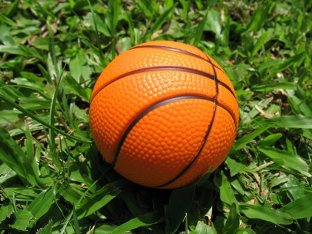 A closeup of a basketball found lying on the grass