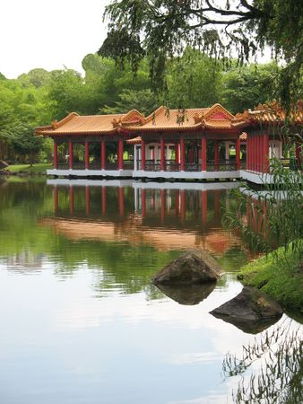 Chinese Pavilion Found at Singapore Chinese Garden set against a lake photo