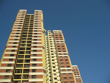 A block of HDB Flats found in Singapore against blue sky. photo