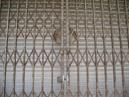 An old style metal door with grill and gate photo