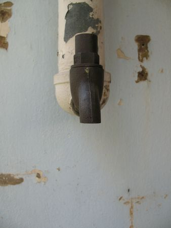 An old rusty water tap with copyspace
