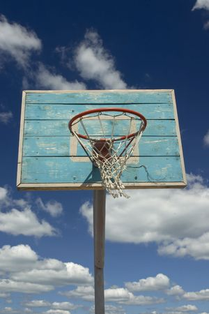 Basketball hoop and net against blue sky with clouds. Stock Photo - 542135