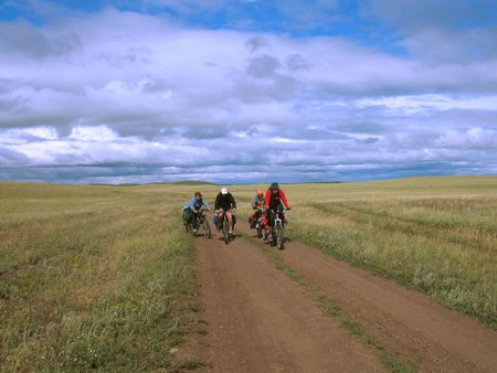 Bicycle travel. Four cyclists go to road. Bike Touring . photo
