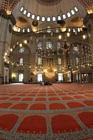 Blue mosque interior with chandelies and carpet.Blue mosque (Sultanahmet mosque) interior. Istanbul, Turkey. photo