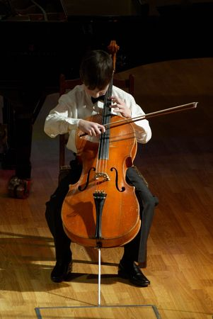 violoncello: Violoncello musicianBoy playing her violoncello at the concert.