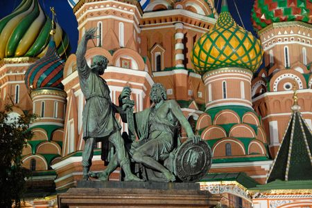 Statue of Kuzma Minin and Dmitry Pozharsky in Moscow Russia(The cathedral was built between 1555 and 1561 by the architects Barma and Postnik Yakoviev. The Minin and Pojarsky monument was erected in 1818.) photo
