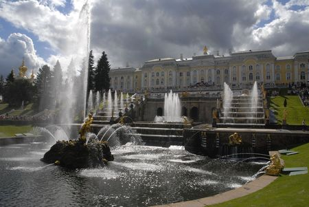 peterhof: Grand Cascade Fountains At Peterhof Palace, St. Petersburg. Fountain Samson in Peterhof, St Petersburg, Russia. The Big cascade - one of the largest gushing constructions of the world. In this cascade are sixty four fountains, two hundred fifty five bronz Stock Photo