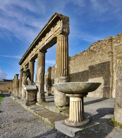 View of Pompeii ruins. Italy. It was destroyed and buried during a catastrophic eruption of the volcano Mount Vesuvius on 24 August 79 AD. The volcano buried Pompeii under many metres of ash, and it was lost for 1,600 years before its accidental rediscove photo