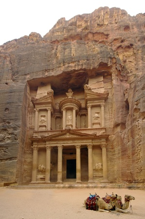 funerary: Facade of the Khasneh (Treasury) at Petra.  Vertical panorama view with two camels at  foreground