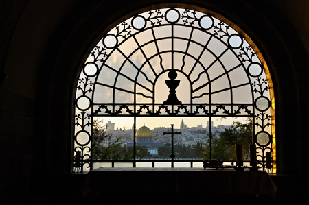 mount of olives: The Old City of Jerusalem, including the Dome of the Rock. View from window of Dominus Flevit church on the Mount of Olives. Stock Photo