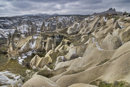 Sandstone formations in Cappadocia, Turkey. At the righ up Uchisar town. photo