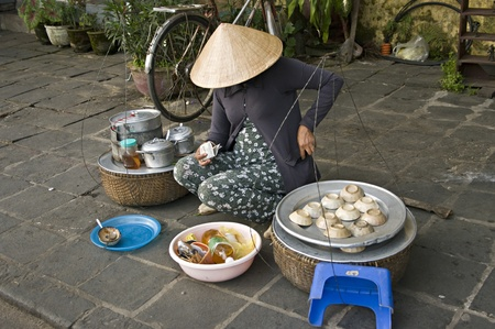 Vietnam street market lady seller  photo