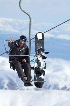 Snowboarder on lift Stock Photo - 358635