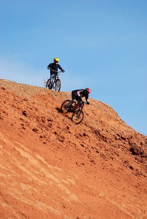 Extreme downhill on red loam hills photo
