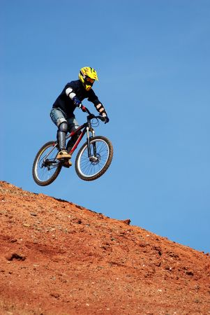 Fly mountain biker photo