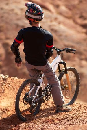 dirt road recreation: Extreme biker on breakaway