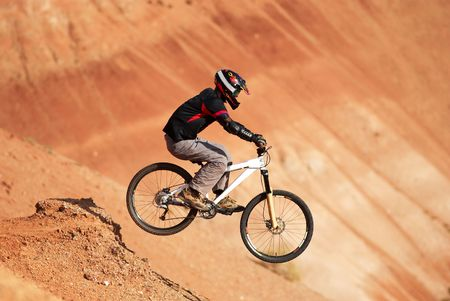 Extreme biker in red canyon Stock Photo