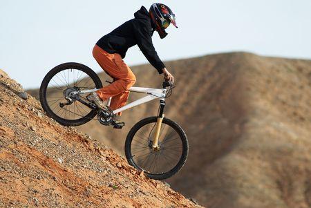 mtb: Girl downhill on bike Stock Photo