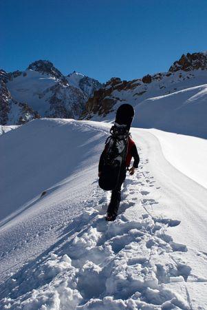 freeride: Snowboarder uphill for freeride