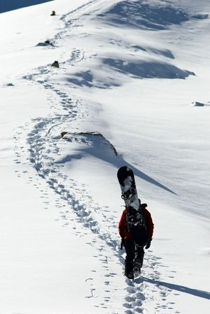 Snowboarder uphill for freeride photo