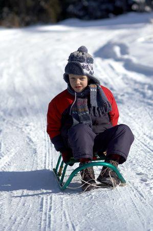 Boy on sled photo