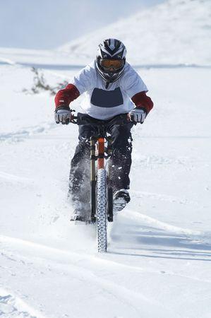 Snow biker downhill photo