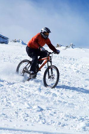Snow Biker downhill on ski mountain resort photo